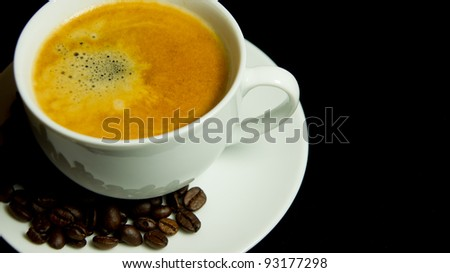 white coffee cup with coffee and coffee beans