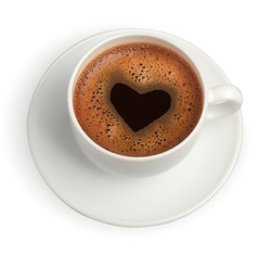 white coffee cup with heart shape made of foam