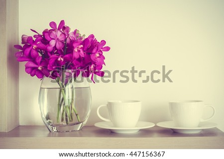 White Coffee Cup With Orchid Flower Vase Decoration Interior Of Room
