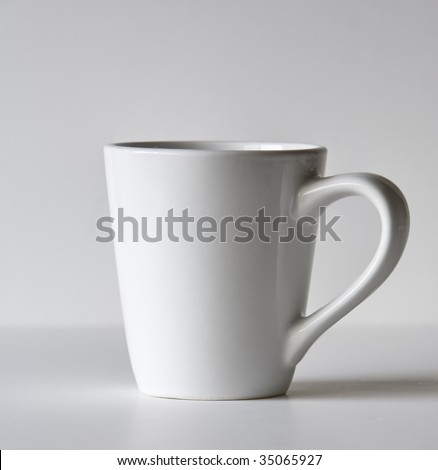 White coffee mug isolated against a white background