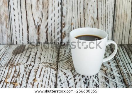 White coffee mug on wood background