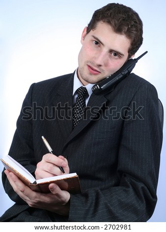 White-collar worker phone and writing over sky-blue background