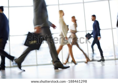 Stock Photo White collar workers going down office corridor during working day