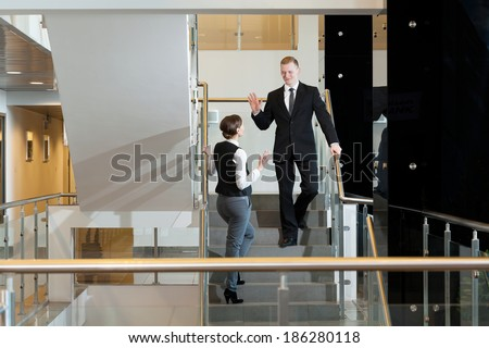 White collar workers on staircese at the office