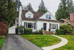 white colonial style suburban house with front walkway