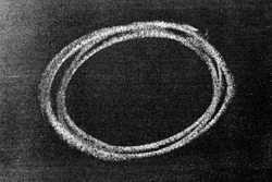 White color chalk hand drawing in circle or oval shape on black board background