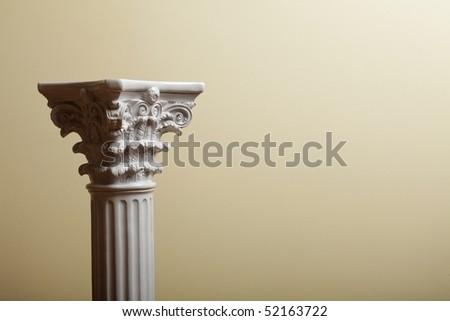 white column on yellow background - stock photo