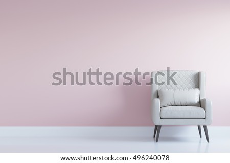 White comfortable arm chair in interior living room with pastel pink wall for copy space. Minimal interior.