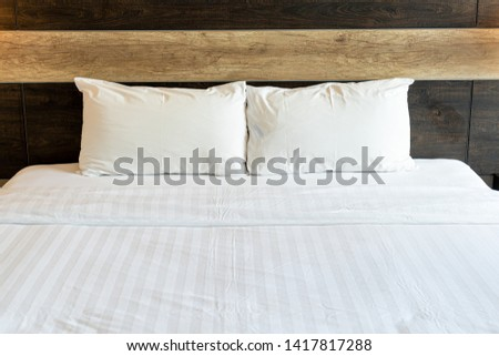 white comfortable pillows on bed