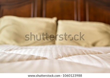 White comforter on bed #1060123988