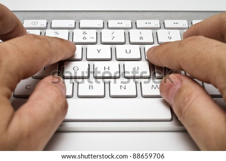 white computer keyboard with hands