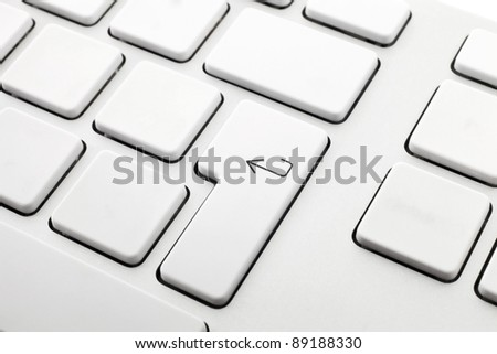 white computer keyboard without letters, one with the enter key - stock photo