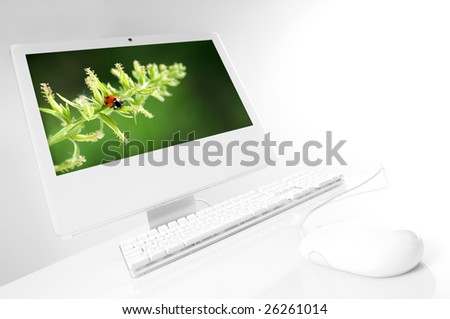 white computer with green screen