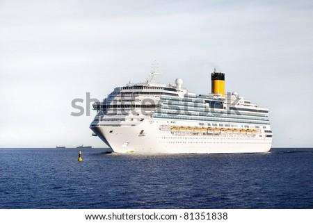 white Concordia-class cruise liner entering the port of Riga