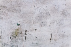 White concrete wall. Old white paint. Beautiful unusual background. Old concrete. Garage. Smears of old paint