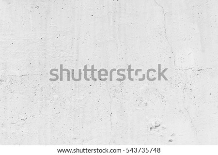 Shutterstock White concrete wall. Small cracks on the surface