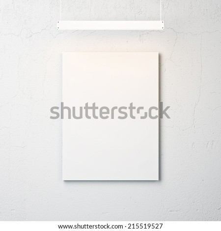 White concrete wall with blank poster and spotlight
