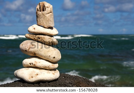 White coral rocks stacked by a meditating zen follower