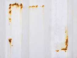White corrugated iron metal texture with Rust Frame corner on surface background
