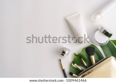 White cosmetic products and green leaves on white background. Natural beauty products for branding mock-up concept. stock photo