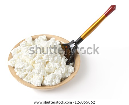White cottage cheese in a bowl isolated on white background