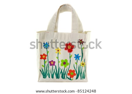 White cotton bag with flower paint by child