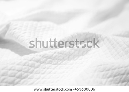 White cotton fabric texture, crumpled blanket, background photo with selective focus #453680806
