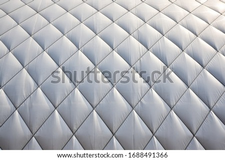 White cover above tennis court in the winter. Tennis hall roofing background.