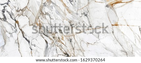 White Cracked Marble rock stone background with gold wavy lines stock photo