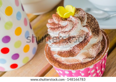 White cream cupcake with chocolate