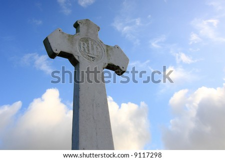 white cross against blue sky - stock photo