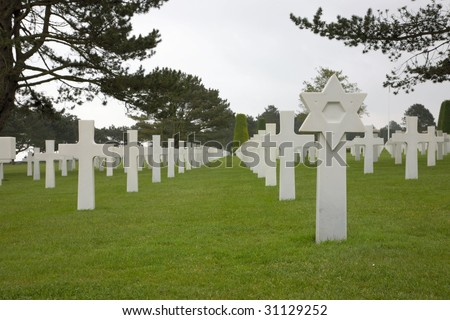 White crosses, David stars and graves at The Normandy American Cemetery and Memorial at Omaha Beach, Normandy, France.