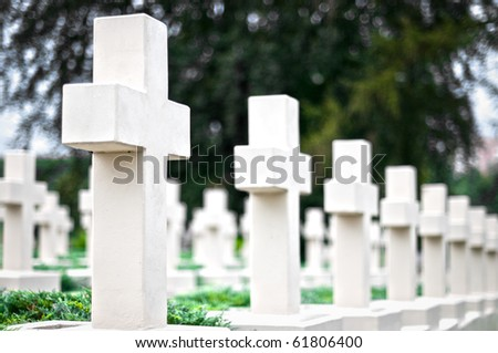 white crosses on the graves of warriors at Lviv cemetery, Ukraine - stock photo