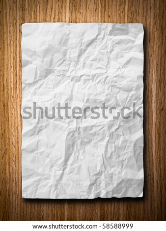 White crumpled paper on oak wood back ground