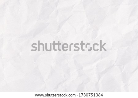Photo of  White crumpled paper texture background.