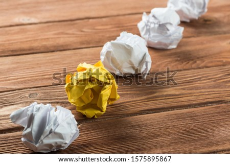 White crumpled up piece of paper on wooden table as idea #1575895867