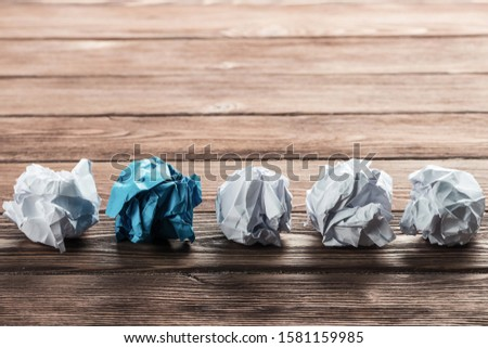 White crumpled up piece of paper on wooden table as idea #1581159985