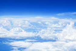 White cumulus clouds clear blue sky background, scenic aerial cloudscape view from airplane, high azure skies backdrop, fluffy cloud texture, sunny heaven, cloudy weather, flight landscape, copy space