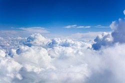 White cumulus clouds on clear blue sky background closeup, overcast skies backdrop, fluffy cloud texture, beautiful sunny cloudscape heaven, ozone layer illustration, scenic cloudy weather, copy space