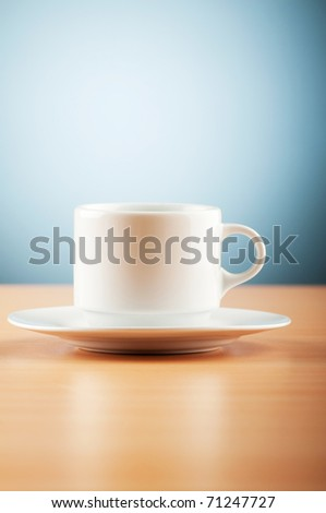 White cup against colourful gradient on the table