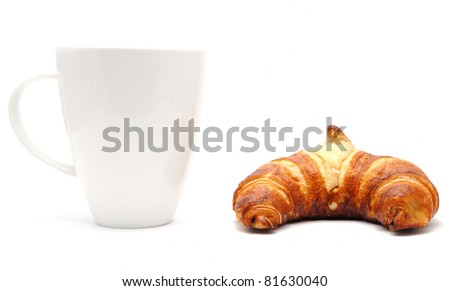 White cup and a croissant, isolated on a white background