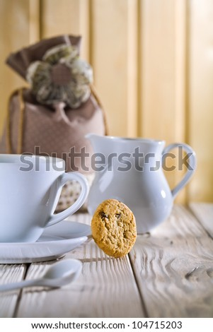 white cup and jug with bag on table