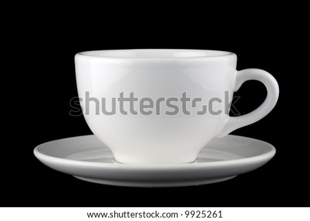 White cup and saucer isolated against black background