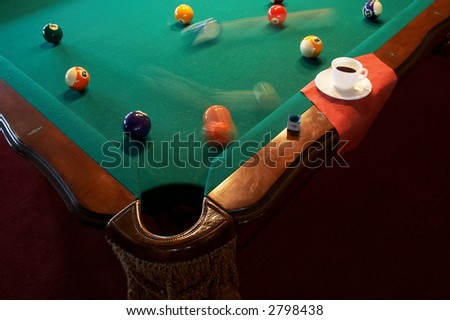 White cup from coffee on a billiard table