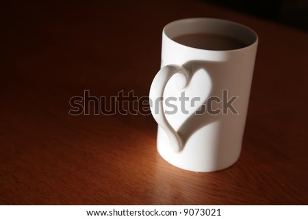 white cup full of drink