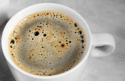 white cup of black coffee from above. top view of coffee bubble close up. caffeine bubble isolated, morning coffee background