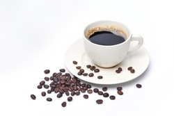 White cup of coffee and coffee beans on white background