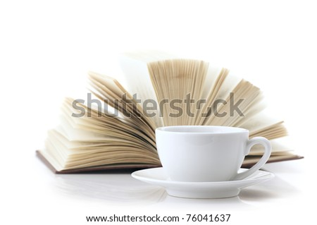 White cup of coffee and open book isolated on white background.