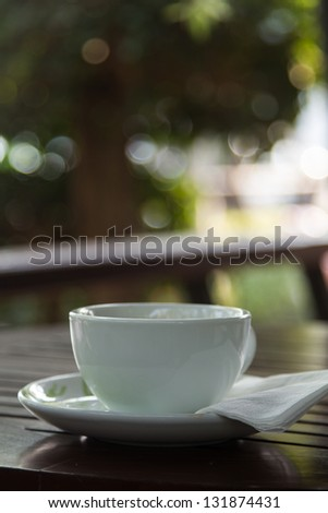 White cup of coffee in a coffee shop