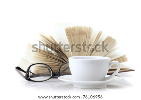 White cup of coffee, open book and glasses isolated on white background.